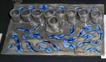 Antique Blue Alligator Glaze with two shades of blue glass beads melted into the carved sections.