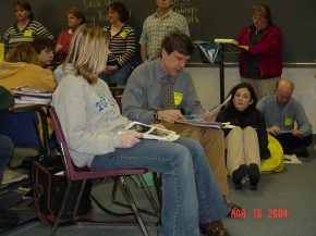 In 2004, Carl Anderson modeled writing workshop in my classroom. Here is he conferring with a student, and there I am watching and learning.