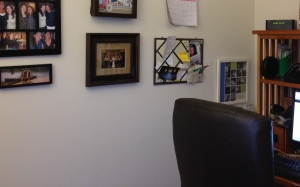 Photos of family and friends are on display to the left of my desk (in my home office).