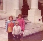 Katherine House (in the pink coat) stands in front of the White House at age 11. She is shown with her two younger sisters. The author grew up in nearby Arlington, Virginia.