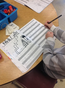 December 2014: One of Kelly's students writing his story in his Kidwriting notebook.